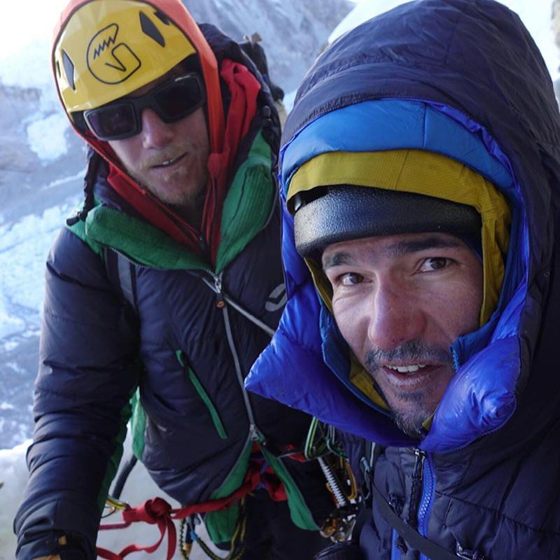 Alan Rousseau and Tino Villanueva pose for a selfie at a bivy ledge part way up Tengi Ragi Tau