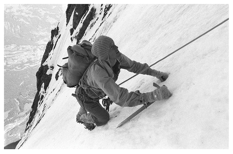 1950s photo of a man climbing ice